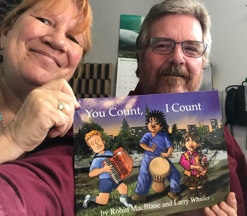 Robin and Larry with You Count I Count book.jpg